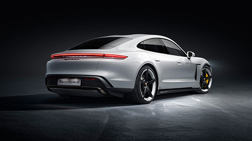 The Porsche Taycan - Rear - Black Background